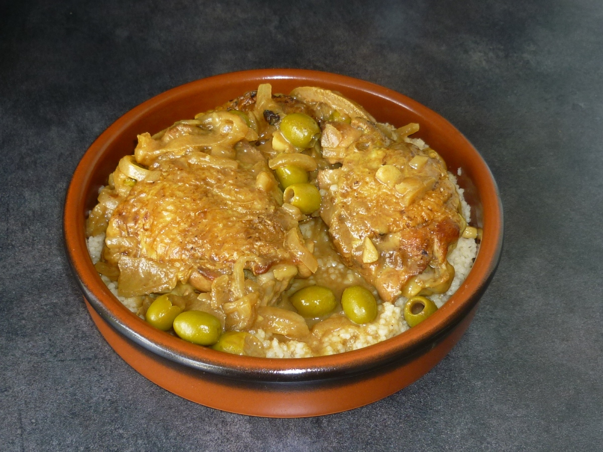 Olives and Lemon Chicken Tajine with Couscous. Morocco